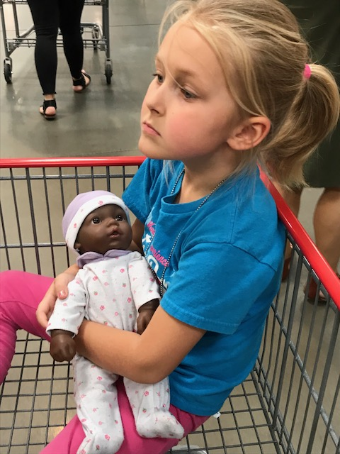 Baby doll in shopping cart