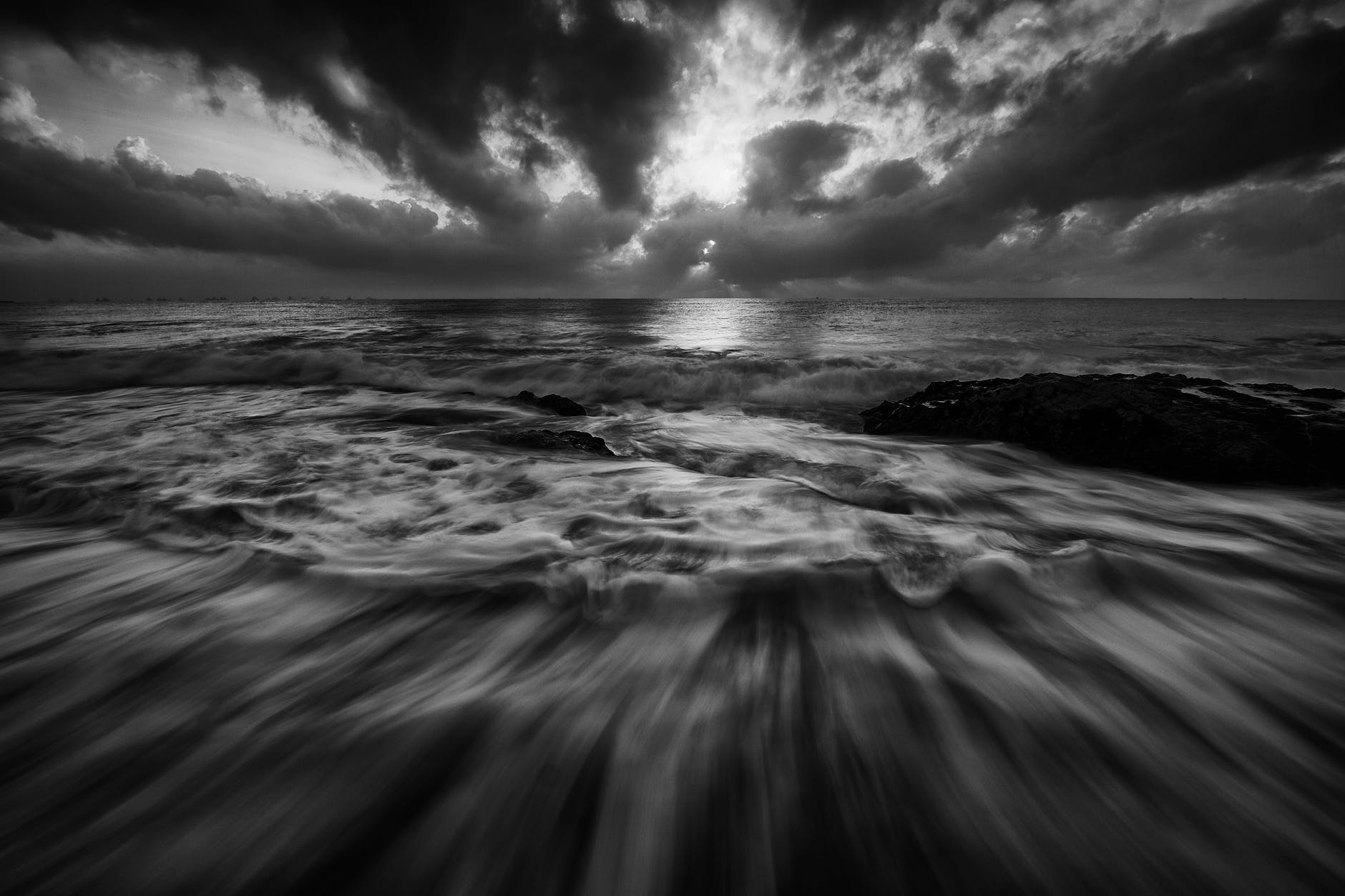 beach black and white dramatic horizon