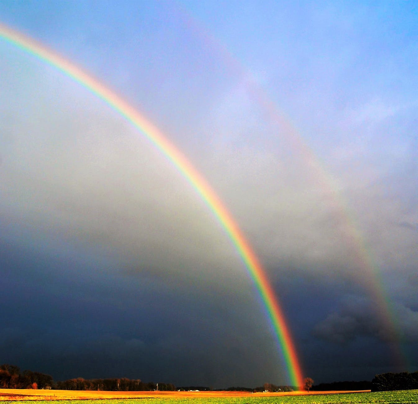 photography of rainbow during cloudy sky